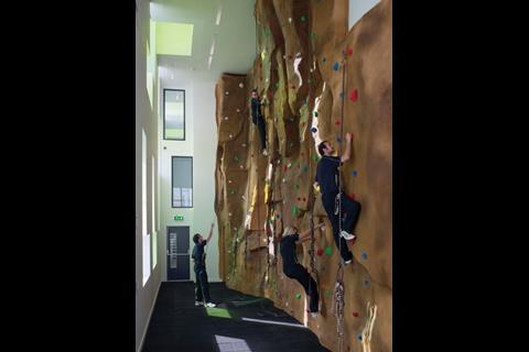 This climbing wall in on the first floor and can be seen from the entrance, providing a hint of the building's sporting functions
